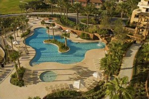 Southern Beach Real Estate and Rentals, LLC. - Luau Towers property aerial view of the swimming pool